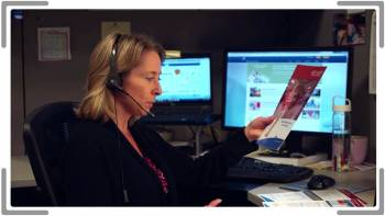 woman on phone looking at training brochure