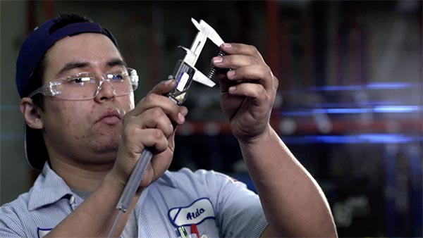 Man checking quality of product in manufacturing plant