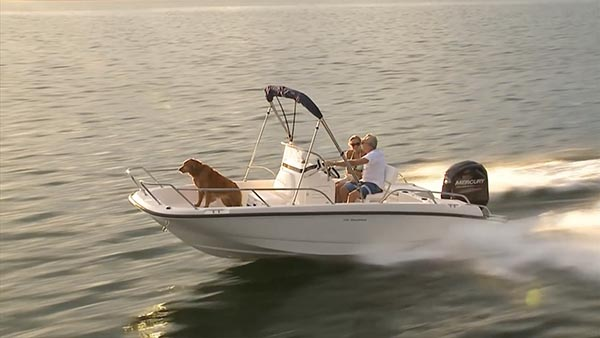 people and dog on a speed boat