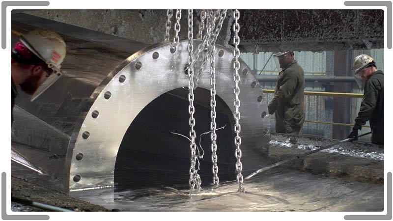 Workers using largest galvanizing tank in marketing video.